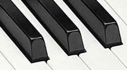 Simulated ebony and ivory keys with optimal fingertip fit for playing ease